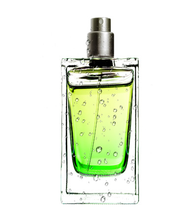 men\'s perfume in beautiful bottle in water drops isolated on white