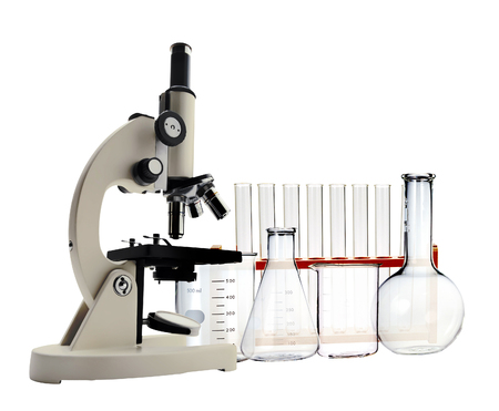 Foto de Laboratory metal microscope and test tubes with liquid isolated on white - Imagen libre de derechos