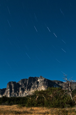 night time star trail and ladnscape with moon light with a very long shutter speed