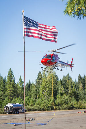Foto de Prospect State Airport, Oregon  - September 9 : Helicopters on the runway ready to fight the 790 fire,September 9 2014 in Prospect State Airport, Prospect Oregon - Imagen libre de derechos