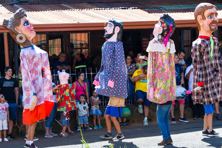 Photo pour Barva, Costa Rica - January 27: Typical masquerade with families watching the show in the shade. January 27 2018, Barva, Costa Rica - image libre de droit