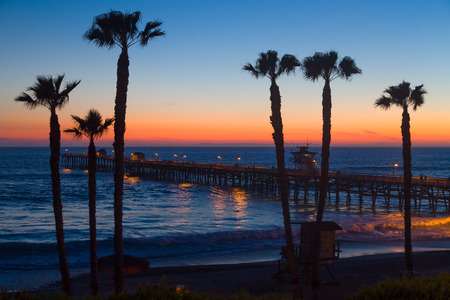 Photo for Beautiful ocean sunset at San Clemente Pier in Southern California, United States. - Royalty Free Image