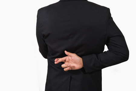 Photo for Businessman in dark suit with crossed fingers behind his back - Royalty Free Image