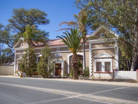 Foto de Omaruru, Namibia - July 17, 2015: Well kept historical colonial building from 1907 on empty street - Imagen libre de derechos