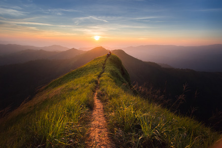 Photo pour The way of climax. Mountain slope have a way for walk. Background is sunset. - image libre de droit