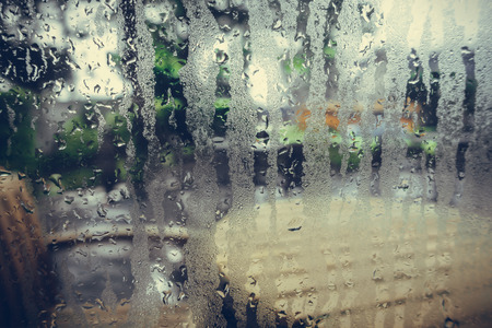 Photo for Water drops from home condensation on a window - Royalty Free Image
