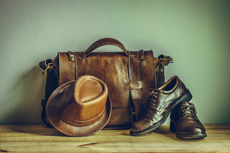 Photo pour Still life with leather suitcase, brown shoes, and old glasses on the book, vintage style - image libre de droit