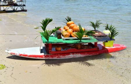 Photo pour Old recycled surfboard has now become an original floating bar. Perfect instrument to entertain tourists on the beach. - image libre de droit