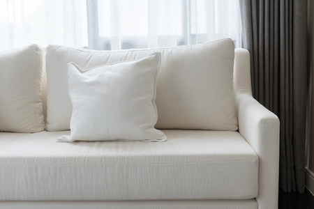 Photo pour white decorative pillows on a casual sofa in the living room - image libre de droit