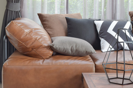 Photo pour Light brown leather sefa bed with varier color and size pillows - image libre de droit
