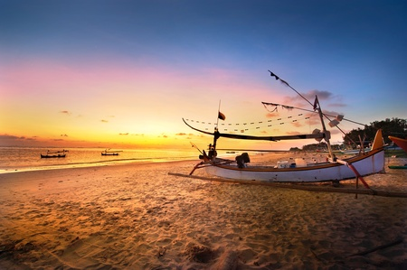 Photo for Drifting boat on the beach at sunset time . Bali , Indonesia - Royalty Free Image