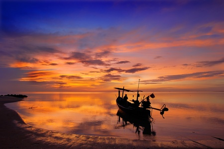 Sunrise and Fishermen boat silhouette in Thailand mural