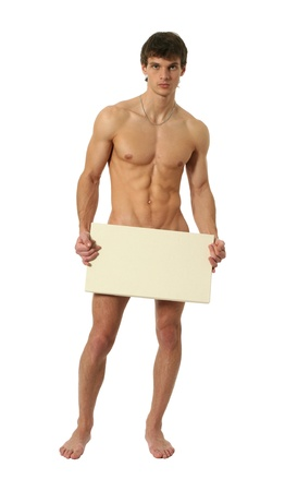 Photo for Nude muscular man covering with a copy space blank board isolated on white - Royalty Free Image
