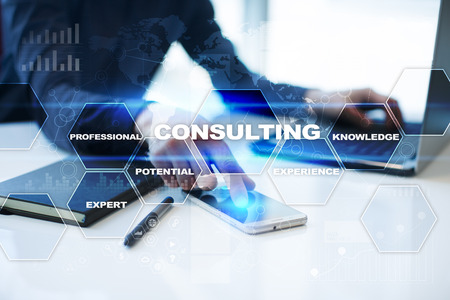 Photo pour Businessman is working in office, pressing button on virtual screen and selecting consulting. - image libre de droit