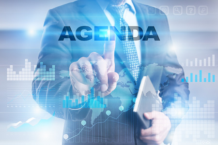 Photo pour Businessman pressing button on touch screen interface and selecting agenda. - image libre de droit