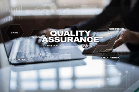 Foto de Quality assurance concept on the virtual screen. Business concept. - Imagen libre de derechos