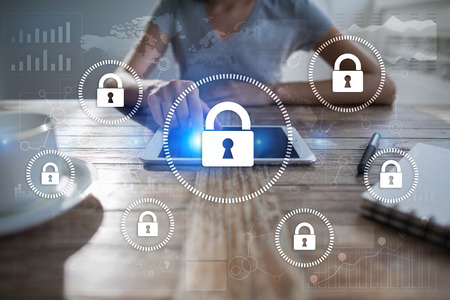 Foto de Cyber security, Data protection, information safety and encryption. internet technology and business concept.  Virtual screen with padlock icons. - Imagen libre de derechos