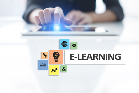 Foto de E-Learning on the virtual screen. Internet education concept. - Imagen libre de derechos