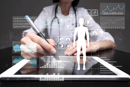 Photo pour Doctor using modern computer with Medical record diagram on virtual screen concept. Health monitoring application. - image libre de droit