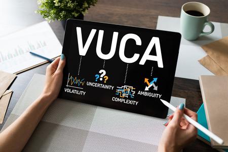 Foto de VUCA world concept on screen. Volatility, uncertainty, complexity, ambiguity. - Imagen libre de derechos