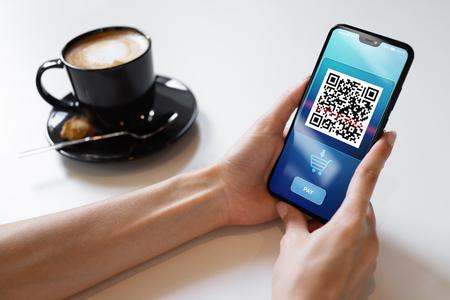 Foto de QR code mobile phone scan on screen. Business and technology concept. - Imagen libre de derechos