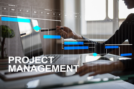 Foto de Project management concept, time and human resources, risks and quality and communication with icons on virtual screen. - Imagen libre de derechos