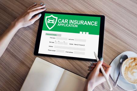 Photo pour Car insurance application form on screen. Internet and business concept. - image libre de droit