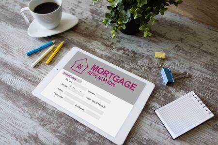 Photo pour Online mortgage application on screen. Property loan. Business and financial concept. - image libre de droit