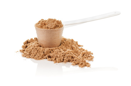 Photo pour Product photograph of scoop of whey protein with visible texture and mirror reflection - image libre de droit