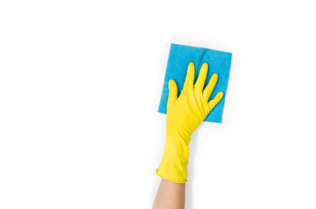 Foto de Isolated womans hand cleaning on a white background. Cleaning or housekeeping concept background. Frame for text or advertising - Imagen libre de derechos