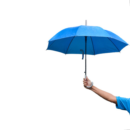Foto de A man's hand holding blue umbrella while rainning - Imagen libre de derechos