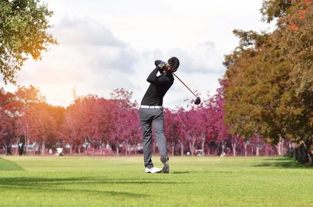 Photo pour Golfers hit sweeping golf course in the Autumn - image libre de droit