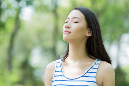 Foto de asian girl taking a deep breath - Imagen libre de derechos