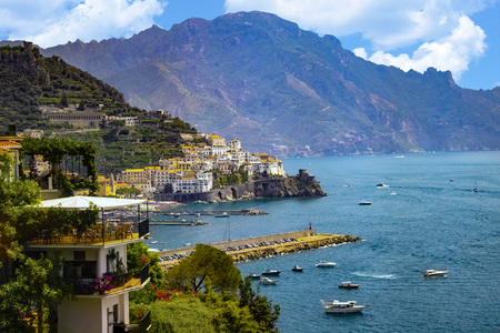 Photo for The view of Amalfi coast. This is on the south of Italy in Europe. The city stands on cliffs above the sea. There are boats on the sea. - Royalty Free Image