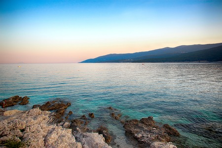 Foto de Sunset over the sea in Rabac Croatia. It is beautiful nature background. - Imagen libre de derechos