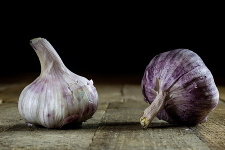 Tasty Italian garlic in an old kitchen on a wooden table, vintage style