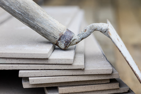 Photo pour Laying and cutting tiles. Tools and building materials at a working position. Tiles for industrial and technical applications. Material Gres. - image libre de droit