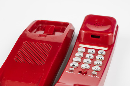 Photo for Old red phone with a handset. A telephone set from the nineties. White background. - Royalty Free Image
