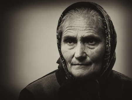 Close up portrait of an old woman isolated on white background