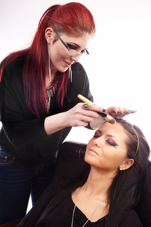 Closeup portrait of a woman having applied makeup by makeup artist