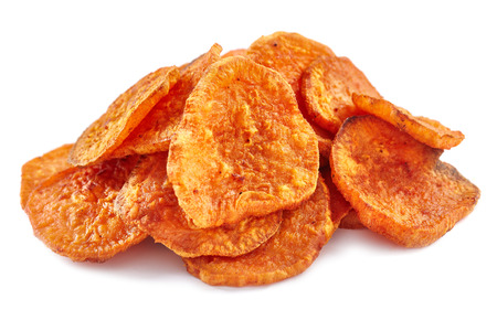 Photo for Closeup of a pile of homemade sweeet potatoes chips isolated on white background - Royalty Free Image