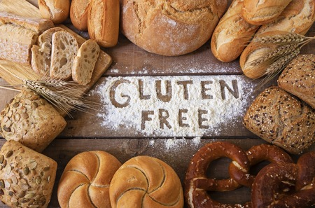 Foto per a gluten free breads on wood background - Immagine Royalty Free