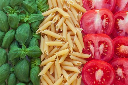 Foto de italian food with background - pasta, tomato, basil - Imagen libre de derechos