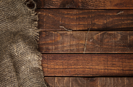 Photo for Burlap texture on wooden table background. Wooden table with sacking - Royalty Free Image