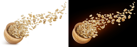 Foto de Oat flakes flying out of wooden bowl isolated on white and black background - Imagen libre de derechos