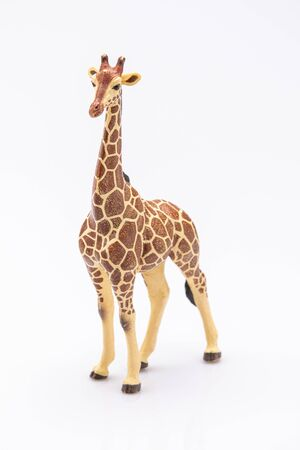 Photo pour close up of a giraffe from a plastic toy isolated on a white background - image libre de droit