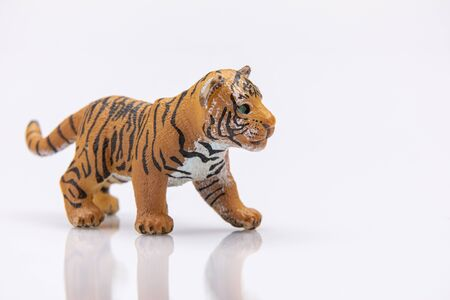 Photo pour close up of a baby tiger from a plastic toy isolated on a white background - image libre de droit