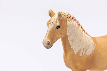Photo pour close up of a brown plastic horse head isolated on a white background - image libre de droit