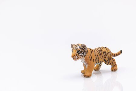 Photo pour close up of a baby tiger toy made of plastic isolated on a white background - image libre de droit