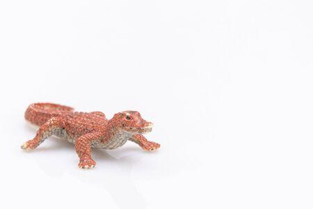Photo pour close-up of an orange plastic crocodile isolated on a white background - image libre de droit